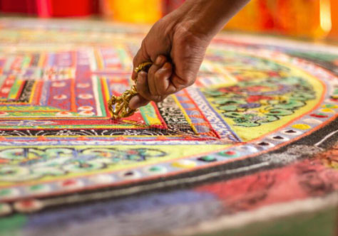 A colorful tibetan mandala in a monastery